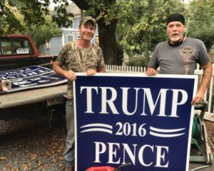 Loading 4x4 Trump Signs in Mullin's truck